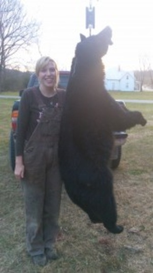 Hunters with bear